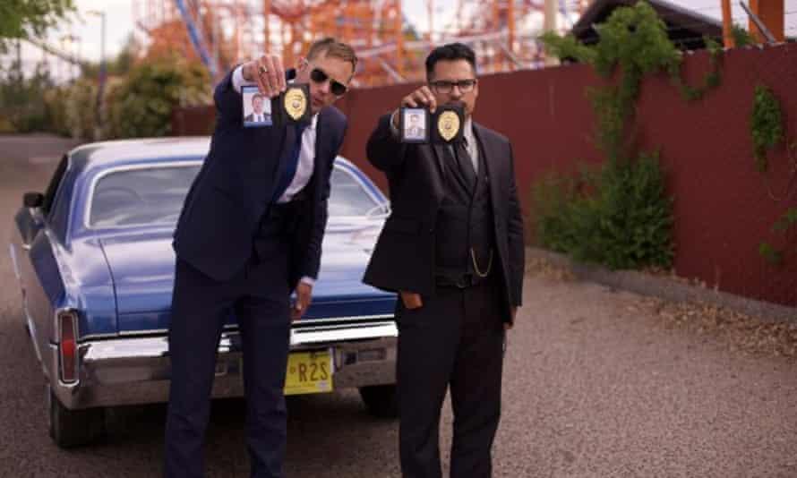 Alexander Skarsgård and Michael Peña in War on Everyone.