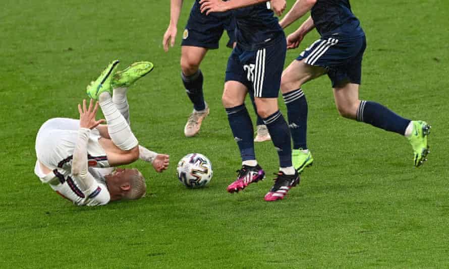 England's Phil Foden takes a tumble
