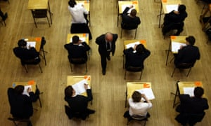 An invigilator and pupils taking an exam