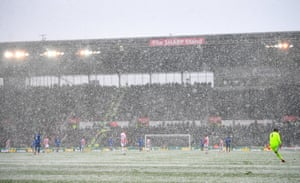 General view of match action through the snow as Stoke lose 2-1 to Everton at the bet365 Stadium.