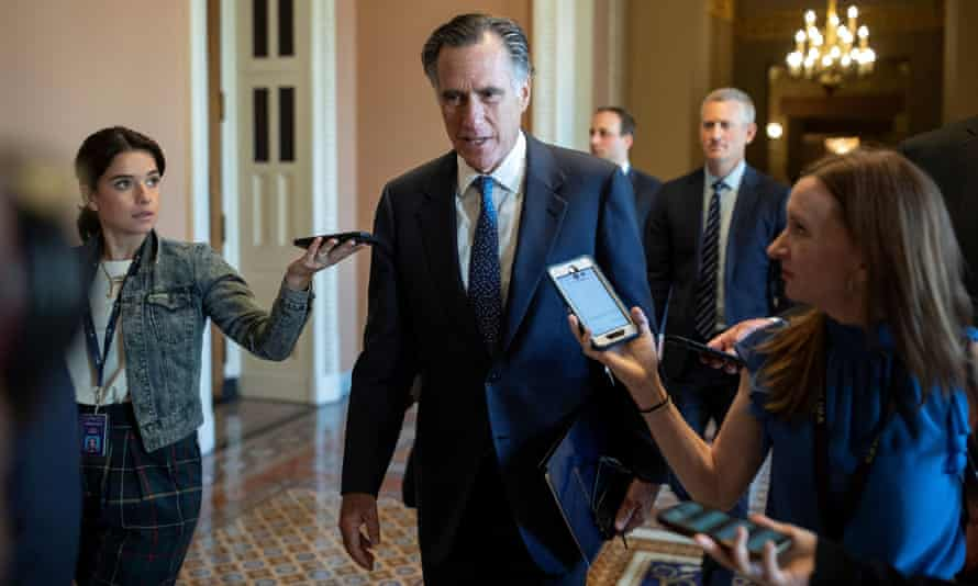 Senator Mitt Romney speaks to news reporters before attending a vote on Capitol Hill on 23 June 2021.