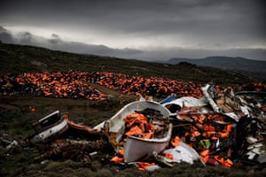 Wrecked boats and life jackets used by refugees crossing the Aegean, abandoned in Greece