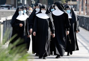 Valencia, Spain. A group of nuns walk along a street in the city where local police are carrying out checks on compulsory use of masks in public spaces