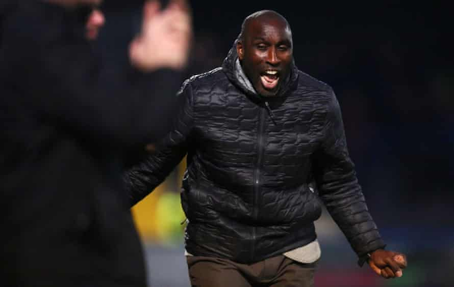 Sol Campbell celebrates one of the Macclesfield goals in the win over Exeter that took them out of the League Two relegation zone.