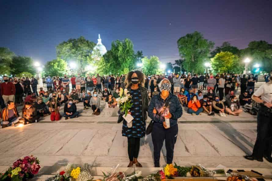 Mourners gather outside the US supreme court.