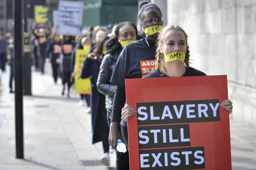 Anti-slavery protesters march in London as part of a coordinated international campaign staged by the A21 abolitionist group in October
