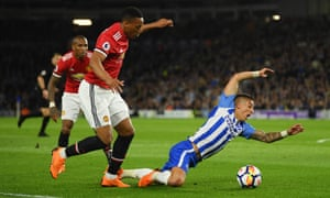 Anthony Knockaert goes down in the box after a challenge from Anthony Martial.