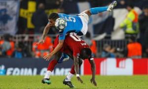 Napoli's Allan tussles with Liverpool's Sadio Mane.