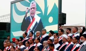 A screen showing Hadi al-Ameri speaking in Basra in April 2018.
