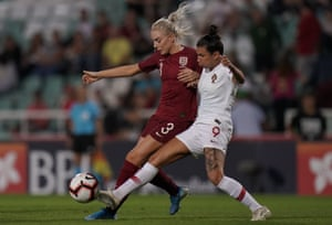 Alex Greenwood fights for the ball with Ana Borges of Portugal.