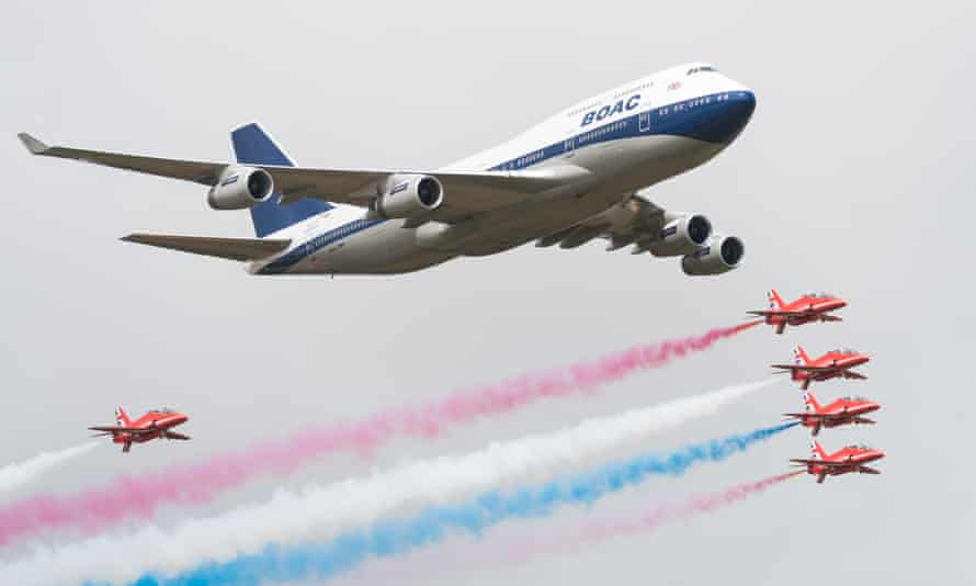 British Airways special liveried Boeing 747 takes to the skies alongside the Red Arrows during the 2019 Royal International Air Tattoo on at RAF Fairford.