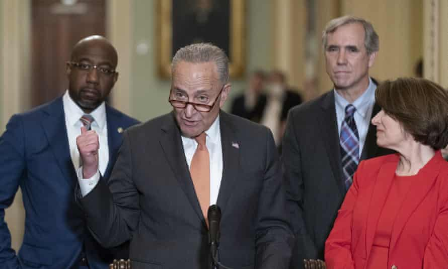 Chuck Schumer, second from left, speaks accompanied by Raphael Warnock, Jeff Merkley and Amy Klobuchar before the vote.