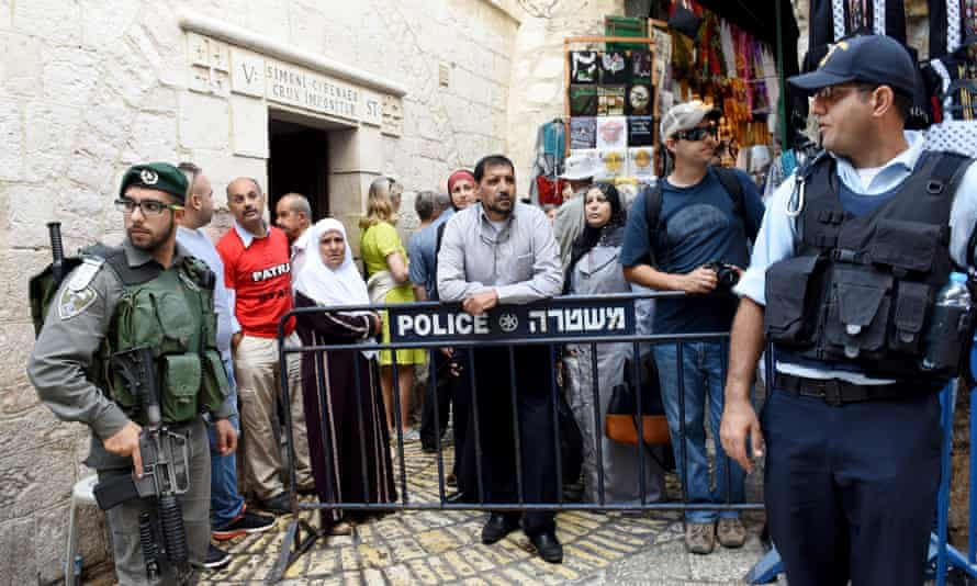 Israeli police stand guard in the Muslim quarter of Jerusalem's Old City