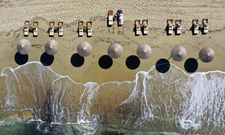 A sunbather on Plaka beach on the island of Naxos