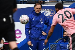 Thomas Tuchel watches from the touchline .