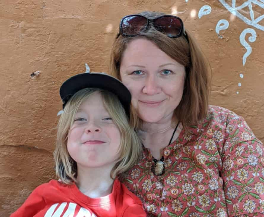 Clare Nowak and her eight-year-old son Ben outside their rented home in Pushkar, about 90 miles from Jaipur.