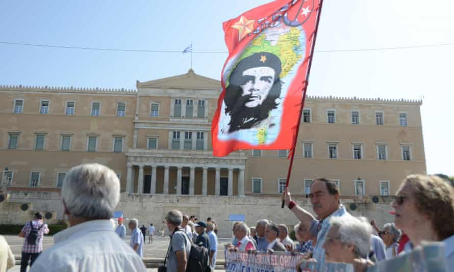 Demonstrators march through Athens to protest against government austerity measures.
