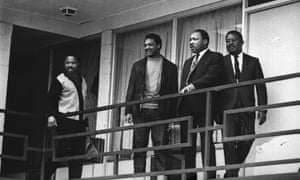 The Rev. Martin Luther King Jr. stands with other civil rights leaders on the balcony of the Lorraine Motel in Memphis, Tenn., on April 3, 1968, a day before he was assassinated at approximately the same place. (AP Photo/Charles Kelly)