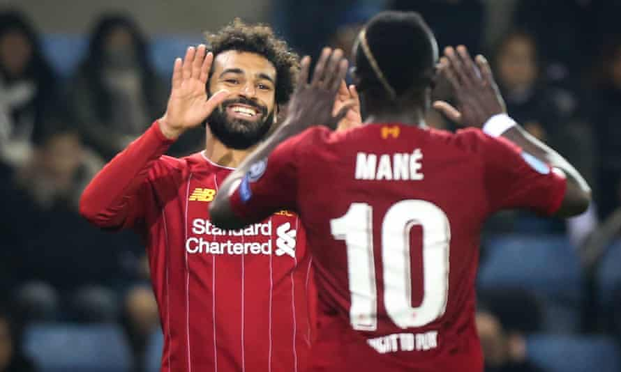 Liverpool's Mohamed Salah, left, celebrates with team-mate Sadio Mane during the 4-1 Champions League win in Genk on Wednesday evening.