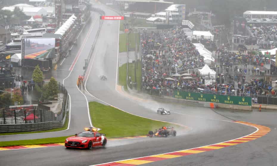 The safety car leads Max Verstappen, George Russell and Lewis Hamilton around Spa