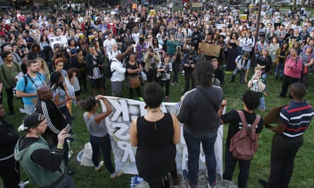 People listen to speakers in Altab Ali Park in east London, as they attend a Black Lives Matter event, on August 5, 2016.