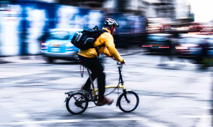 Cyclist wearing a helmet in central London