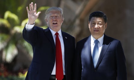 President Donald Trump and Chinese President Xi Jinping pause for photographs at Mar-a-Lago, in Palm Beach.