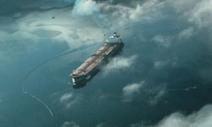 Containment booms surround the oil tanker Exxon Valdez after it ran aground in Prince William Sound, Alaska, March 1989.