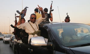 Militia fighters chant slogans against Isis in Basra