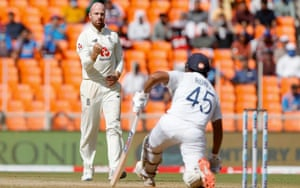 Jack Leach celebrates as his delivery takes the wicket of Rohit Sharma.