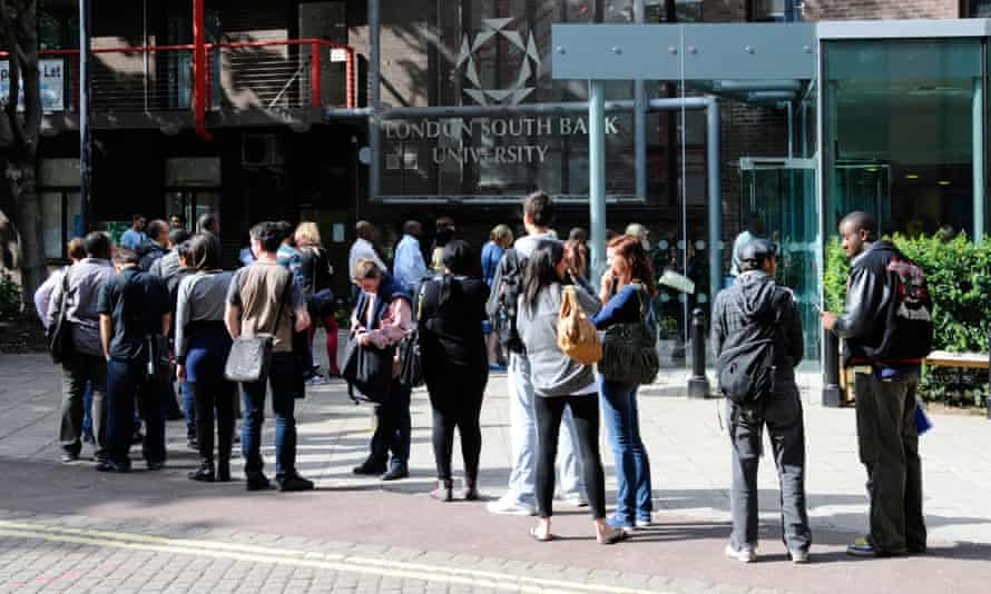 Students queuing outside entrance to London South Bank University.