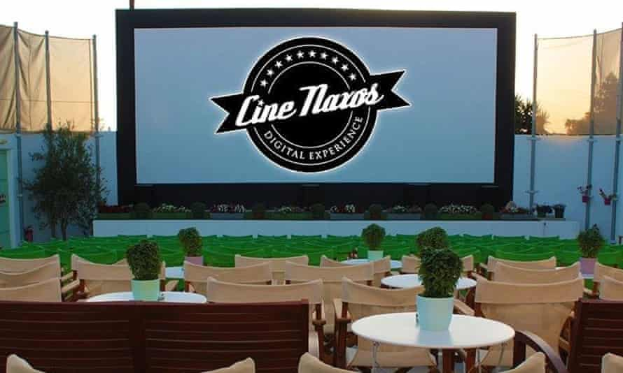 Cine Naxos with screen, chairs and tables