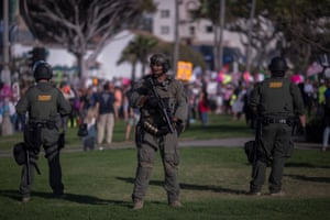 Sheriff's deputies form a line to keep demonstrators and counter demonstrators apart during an 'America first' demonstration in California. Sheriffs across the US have said they won't enforce state mask orders.