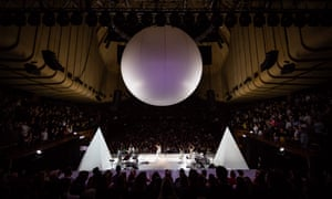The stage was transformed with two pyramids on each side and a giant sphere hanging from the ceiling