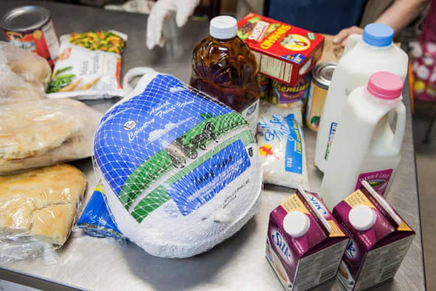 NEW YORK, NY - November 23rd, 2015: Zoila Estrella, 74, a volunteer at the West Side Campaign Against Hunger, checks recipients out in the food pantry on Monday morning. CREDIT: Alex Welsh for The Guardian