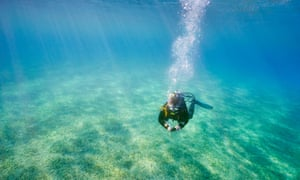 Single scuba diving underwater