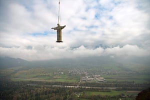 An 11m tall replica of Rio de Janeiro's Christ the Redeemer statue, that was originally exhibited at the Bad Ragartz art show in 2015, is transported by helicopter from its old home to a new location near the Wartenstein ruin in Pfaefers, Switzerland
