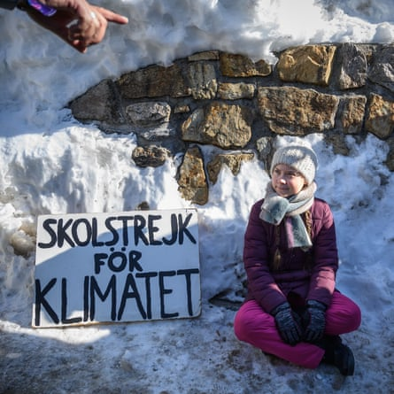 """Thunberg with her """"school strike for climate"""" placard outside the World Economic Forum meeting in Davos in January."""