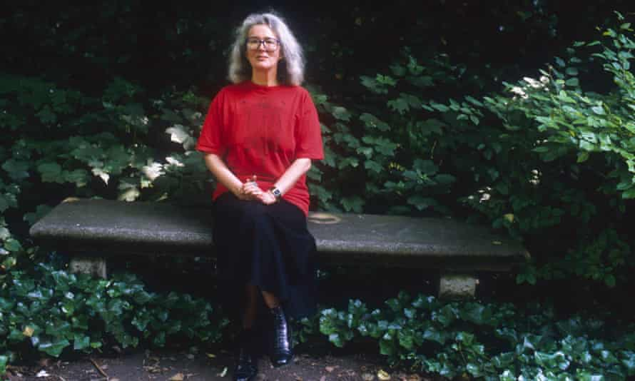 English novelist Angela Carter sitting on a park bench in Paris in 1988.