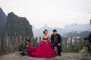 A couple photographed in front of the famous misty mountains in Guilin.