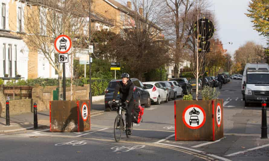 A cyclist at the edge of a low-traffic neighbourhood in Hackney, London