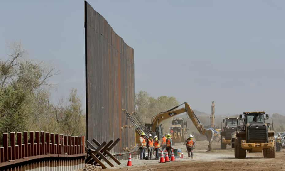 Contractors erect a section of border wall, replacing smaller fortifications, along the Colorado River in Yuma, Arizona, in September 2019.