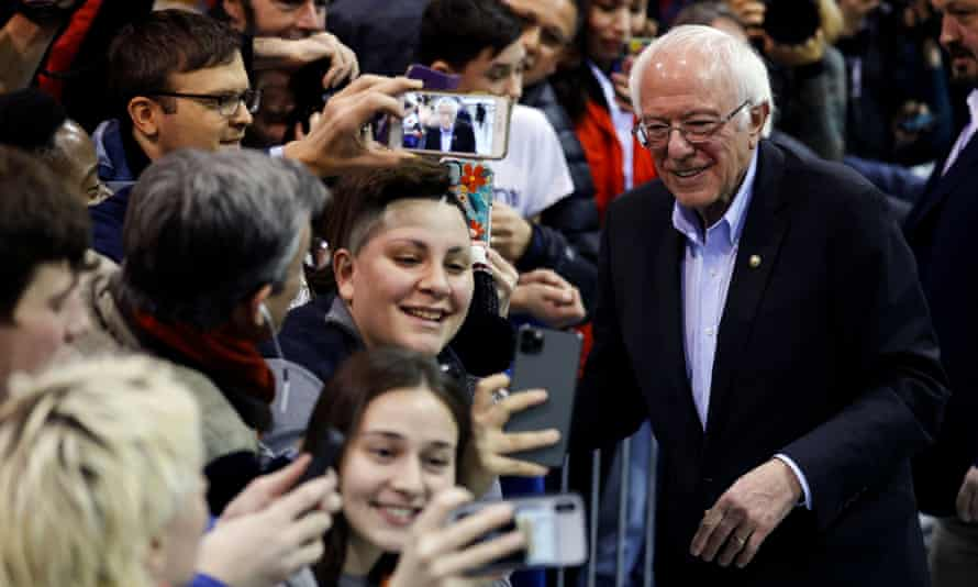 Bernie Sanders poses for selfies at at campaign rally in Rindge, New Hampshire
