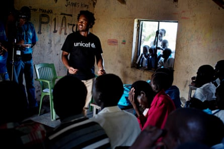 Ishmael Beah talks to a group of children in Pibor
