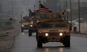 US troops drive through Manbij in north-west Syria