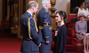 Victoria Beckham holds her award after she was made an OBE by the Duke of Cambridge.