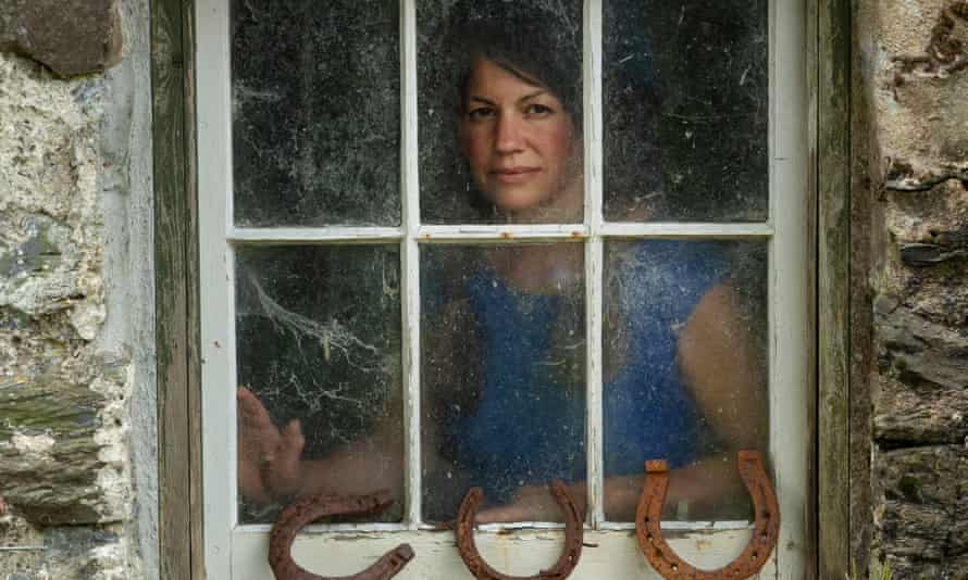 Tamsin Calidas seen through the window of an old stone building