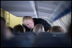 Johnson talks to aides while flying to Scotland on the first day of the election campaign, November 7