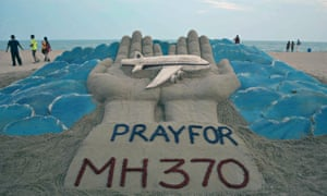A sand sculpture with a message of prayer for the victims of the MH370 disaster at Puri beach on the east coast India.<br>