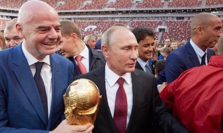 Fifa president Gianni Infantino and Vladimir Putin with the World Cup at Luzhniki stadium in Moscow.